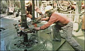 Workers at an oil rig