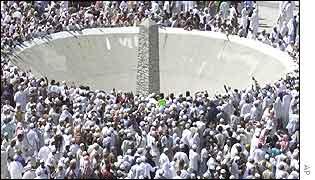 Pilgrims ritually stone a pillar