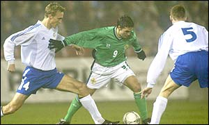 Finland's Sami Hyypia moves to to tackle Northern Ireland striker David Healy at Windsor Park