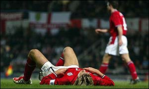 England captain David Beckham is flat out during the first half of the defeat against Australia