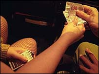 Money being handed to a prostitute