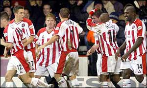 Sheffield United players celebrate Michael Tonge's goal against Liverpool in the  Worthington Cu
