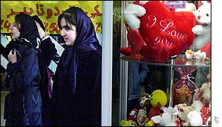 Iranian women pass a shop displaying Valentine's Day hearts and toys in Tehran
