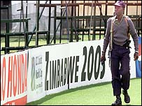 A policeman patrols the empty Harare Sports Club on the day of the cancelled game between England and Zimbabwe