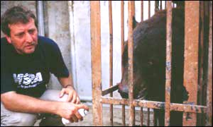 Victor Watkins and a caged bear