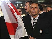 Nasser Hussain carries the flag