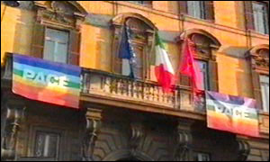 Rainbow-coloured flags displayed in support of peace demonstrations on 15 Feb, 2003 
