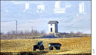 A North Korean tractor rides near the North Korean village of Gichungdong,