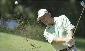 Ernie Els plays out of a bunker in Perth