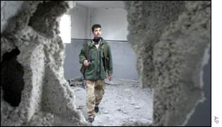 A Palestinian man in a bombed out house in Rafah