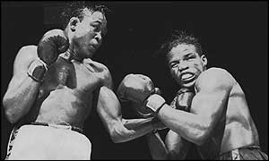 Cuban-born American fighter Kid Gavilan connects with a solid left to the jaw of Gil Turner