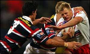 Saints' Darren Albert fails to get through the Sydney Roosters defence.