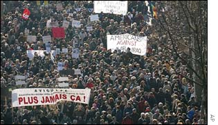 Demonstrators holding anti-war banners take to the streets of Paris