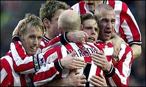 Anders Svensson (second right) is mobbed after opening the scoring for Southampton