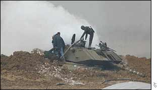 Rescuers look into damaged tank