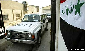 UN inspections vehicle drives past Iraqi flag in Baghdad