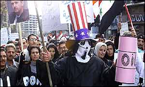 Syrian protester marches dressed as Uncle Sam with skull and mock oil drum