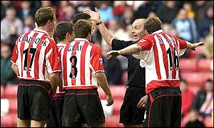 Sunderland players protest to the referee