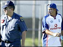 England captain Nasser Hussain and a security guard