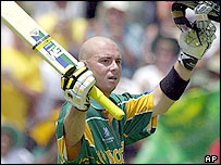 Herschelle Gibbs celebrates his century against New Zealand