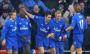 Chelsea's players congratulate scorer Hasselbaink