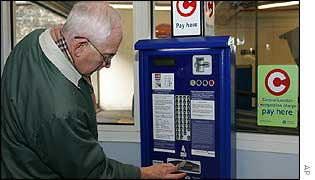 Roger Wooley from Maidstone pays at a self-service machine in Westminster