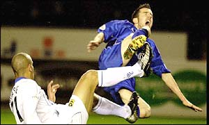 Portsmouth's Nigel Quashie sends Muzzy Izzet flying