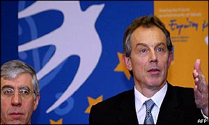 UK Prime Minister Tony Blair addresses a news conference with Foreign Minister Jack Straw