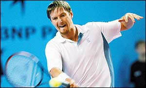 Yevgeny Kafelnikov attacks a forehand