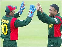Khaled Mahmud (right) celebrates with captain Khaled Mashud