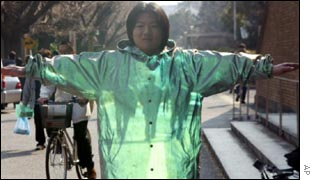 Japanese scientist wearing invisibility coat