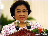 Indonesian President Megawati Sukarnoputri speaks to the media during the visit of the Australian Prime Minister John Howard to Jakarta on February 15, 2003