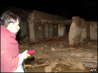 A man inspects the remains of his home after the floods subside