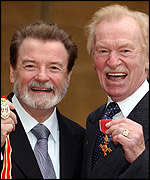 Weedon (right) collecting his OBE with Sir James Galway