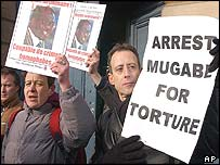 Human rights campaigner Peter Tatchell protests in front of the Justice Ministry in Paris