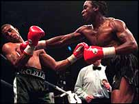 Nigel Benn lands a right hand on Gerald McClellan
