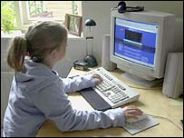 Girl using a PC at home
