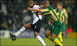 Fulham's Steve Marlet holds off West Brom's Neil Clement