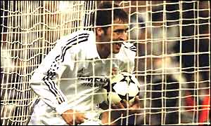 Raul picks the ball out the back of the net after equalising for Real Madrid