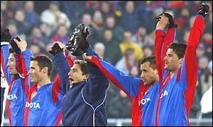 Basle raise their hands to their supporters to celebrates beating Deportivo La Coruna
