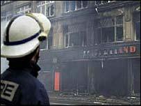 A firefighter surveys the damage