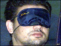 Bombing suspect Aeroubi Beandalis wearing an eye mask in a file photo from 2002