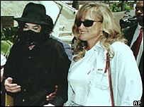 Michael Jackson with his former wife Debbie Rowe (right)