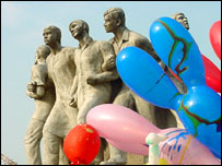 Balloons by a statue of Bangladeshi martyrs