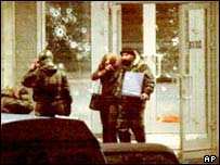 Russian special forces help a hostage to leave the theatre