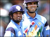 Sachin Tendulkar and Sourav Ganguly look up at the scoreboard against Zimbabwe
