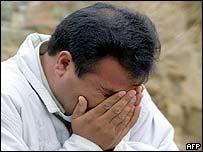 A victim's relative weeps