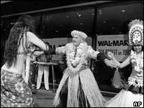 Former chairman and founder Sam Walton celebrates Wal-Mart pre-tax profits