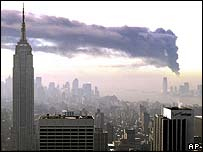 Smoke from the burning oil terminal drifts across New York