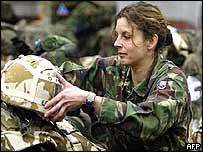 A British soldier prepares kit